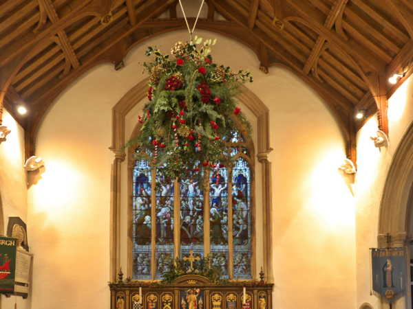 Flower arrangememt suspended from celiling in Choir