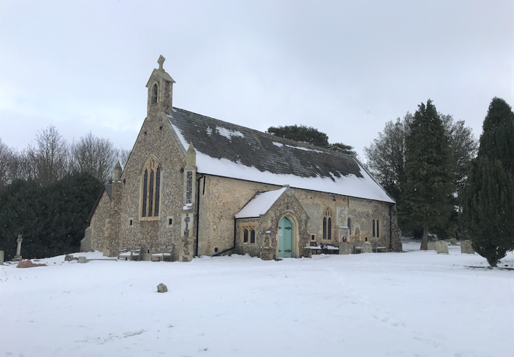 A church in the snow  Description automatically generated with medium confidence